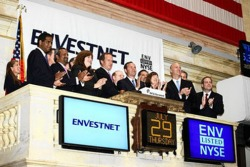 Envestnet officials celebrate the company's IPO at the New York Stock Exchange, July 29, 2010.
