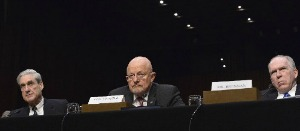 FBI Director Robert Mueller, Director of National Intelligence James Clapper and CIA Director John Brennan testify before the Senate Select Intelligence Committee in 2013