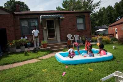 Children at a block party in Jennings, a suburb in north St. Louis County, has shifted since the 1960s from almost entirely white to 90 percent black. Photo: Edwin Torres/ProPublica
