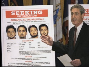 FBI Director Robert Mueller with wanted poster for Adnan El Shukrijumah in 2003.