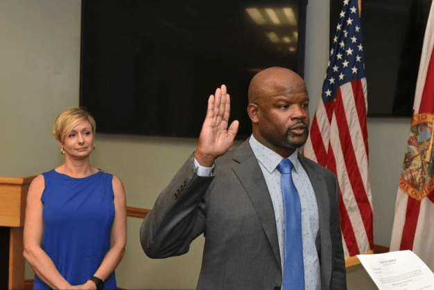 Broward Sheriff Gregory Tony being sworn in on Jan. 11, 2019 as his wife, Holly, looks on